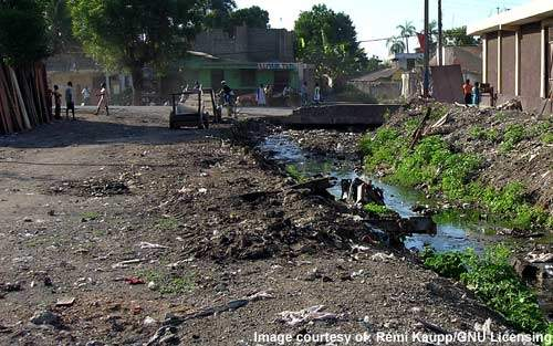 Blocked drainage channels, excreta and waste on the ground - the evidence of poor sanitation. Some 80% of all disease in developing countries arises as a direct result of this.