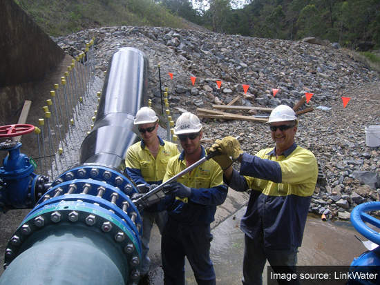 The Toowoomba Pipeline Alliance crew connect the last pipe to the Cressbrook Dam wall.