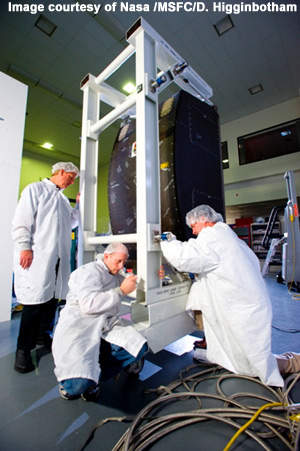 Nasa engineers Tom Phillips, Phillip West and Robert Rutherford prepare one of the two International Space Station water recovery system racks for transport.