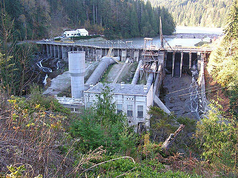 The Elwha Dam, built in 1913, will be demolished to help restore the Elwha River ecosystem.