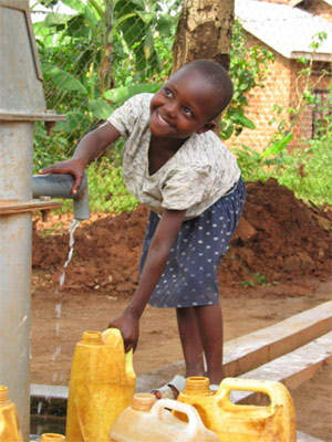 A young girl at the clear water well at the Mercy Home for Children, Kampala. Since 2005, NWSC have made great advances in supplying the underprivileged areas of Kampala, now serving about 85% of the urban poor, who previously had to rely on untreated water from contaminated wells.