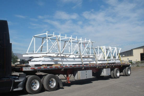 Equipment being carried for the construction of the gravity thickener building.