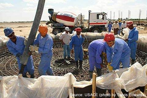 Iraqi workers placing concrete for the clarifier tank at the WTP.