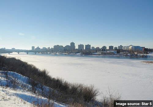Looking across the South Saskatchewan River towards Saskatoon in winter.