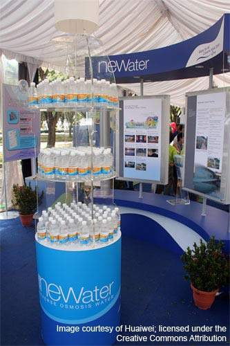 Bottles of NEWater for distribution at a public exhibition during the National Day Parade celebrations 2005. Singapore's Four National Tap strategy involves rainfall, imported water, reclaimed water and desalination to meet its growing needs.