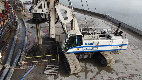 A drill rig in operation at the construction site of the Wolf Creek dam foundation remediation. Image courtesy of USACE / Lee Roberts.