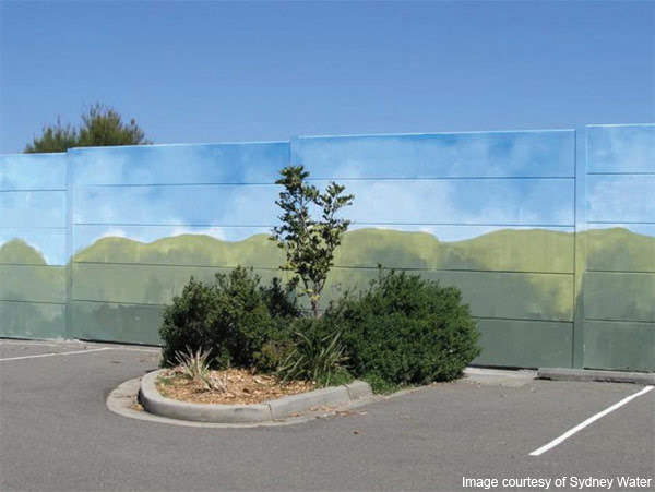 The installed fence around the staging area was painted and landscaped with native species to reduce its visual impact.