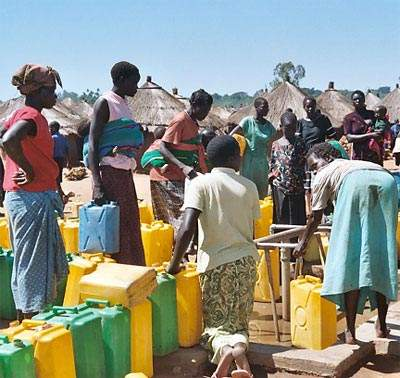 Women line up at a new bore hole at Labuje, Uganda. The Ugandan government is committed to the provision of sustainable water resources for the future – and universal access to a safe supply by 2015.