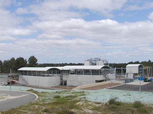 The MIEX plant viewed from the east; the contactor tank is in the middle and the three settler tanks are to the left.