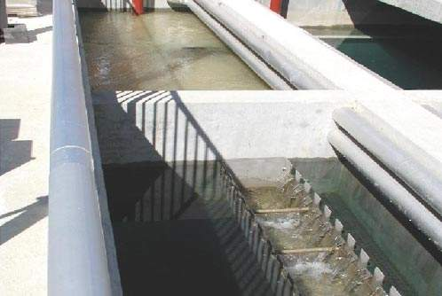 The sedimentation tanks; enhanced sedimentation removes particulates using a combination of conventional coagulants and the addition of very fine sand to increase floc weight.