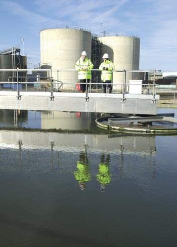 Wastewater treatment at Millbrook consists of largely traditional elements; the sludge digesters form the background, with final settlement tanks to the fore.