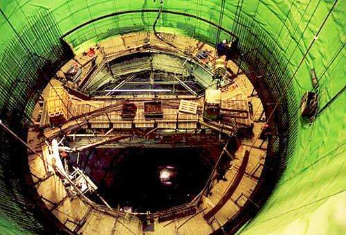 Looking down the vertical shaft towards the hydraulic slipform system work platform.