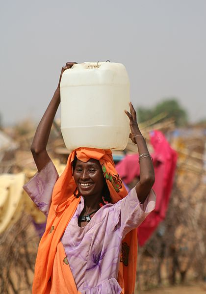 Woman carrying water can